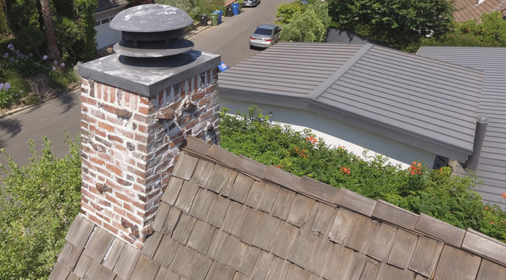 brick chimney on shake roof